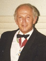 Malcolm Williamson with medal
