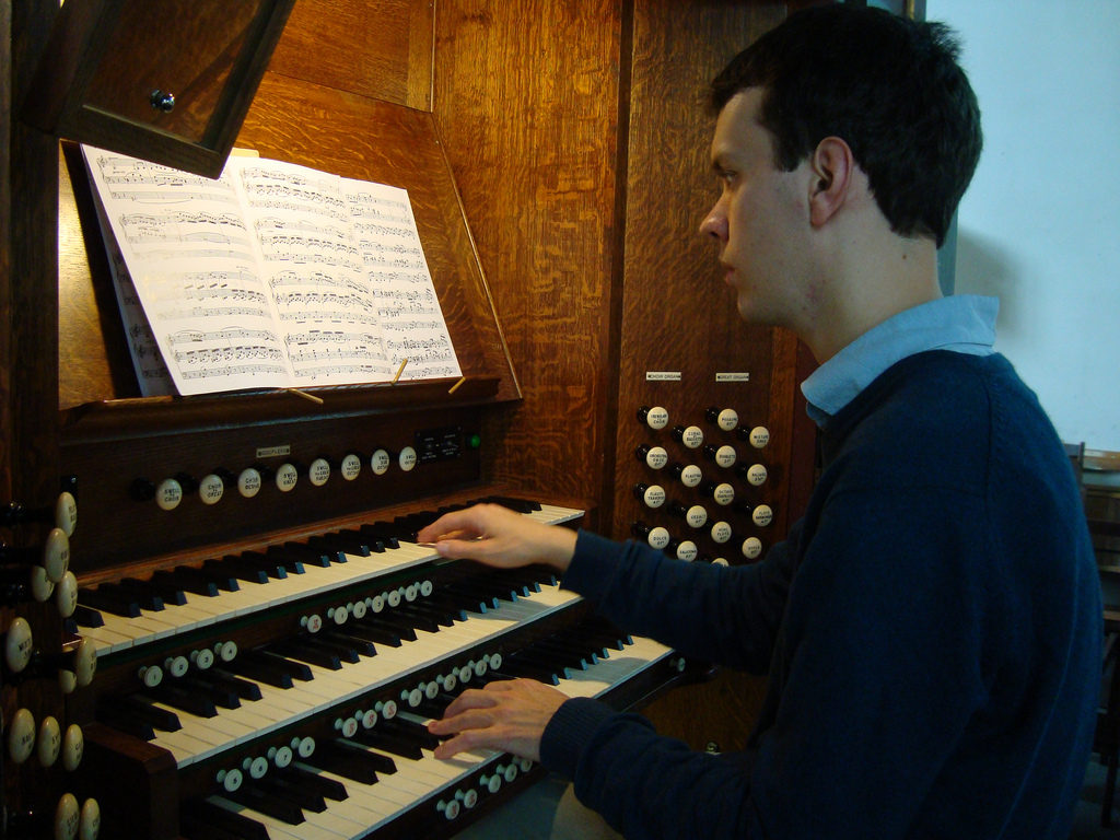 Tom Winpenny at the organ of Queens' College, Cambridge